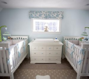 Blue and brown baby nursery photo